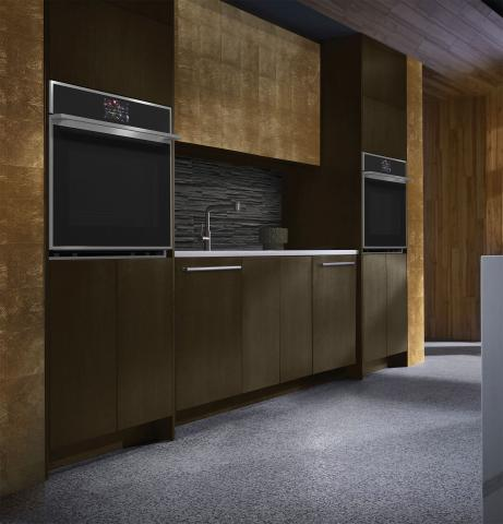 brown and gold kitchen cabinets with double wall ovens