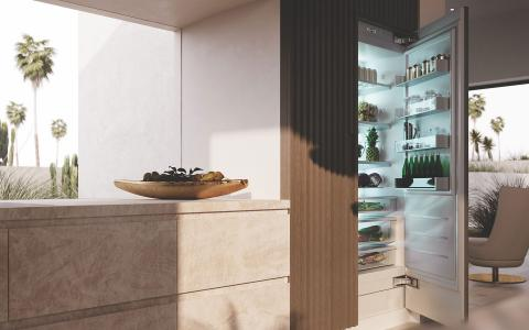 Built in refrigerator with textured wood cabinetry panels
