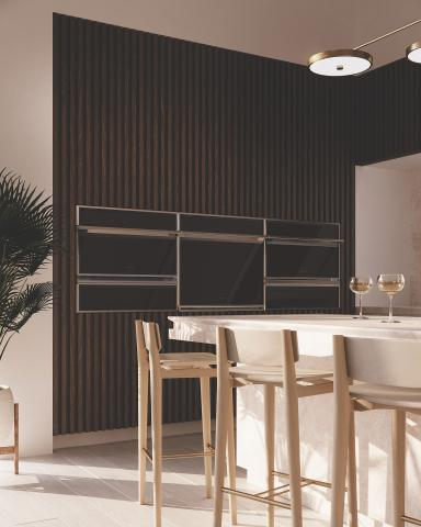 modern wood paneled wall with multiple built in ovens